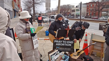 Above: Tommy Quinn, who has protested abortion in Worcester since 1985,  holds a sign outside the Planned Parenthood buffer zone on Pleasant Street.